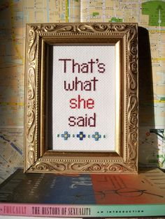 That's what she said completed cross stitch, framed in secondhand frame.