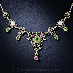 A thoroughly charming, bright and colorful Arts & Crafts period necklace dating back to the turn-of-the-twentieth century. The artfully scro...
