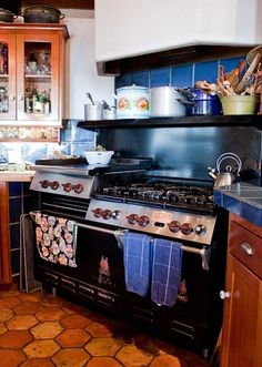 I like the shelf for pots over the stove. (The stove itself is pretty enviable, as well.)