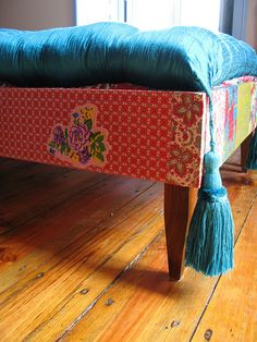 I LOVE this idea!  Wrap a wooden bed frame in a fun fabric for extra pop
