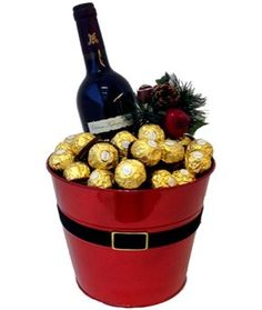 Chateau Kefraya 2009 with 500 grams of Ferrero Rocher chocolate arranged in decorated bucket. Perfect gift to wish your loved ones cheerful holidays! $72.00