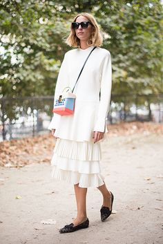 Candela Novembre poses wearing a Ferragamo dress and a The Volon bag after the Paco Rabanne show at the Jeu de Paume during Paris Fashion Week...