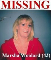Flint police have identified the woman found dead inside a house on the city's east side as missing person 43-year-old Marsha Woolard.