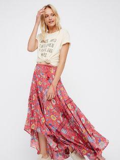 Lovebird Half Moon Maxi Skirt | Easy breezy maxi skirt featuring a bold exotic print. Effortless drawstring tasseled ties at the waist. Femme, flowy silhouette.