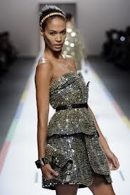 """#FENDI  Is Bringing Alot Of Different Ideas To Their Collection This Spring! From """"Color Blocks; To Interesting Cuts & Patterns. However, They've Also Incorporating A Substantial Amount Of Glam! Just Take A Look At This  #EveningDress  It's Perfect For A Night Out. Beautifully Designed And Full Of """"Sparkle!"""" Now Add On The  Sexyness""""  Now Who Can Go Wrong With The Matching  #Clutch   #WomansFashion"""