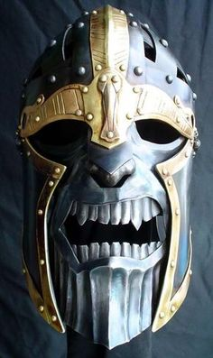 From the Hammered Wambat - Steve Belden. I really love this guys work. Wearable sculpture, these are functional Helms. TB. viking helm