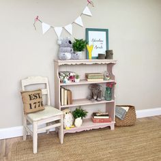 Let this adorable pink bookshelf add some pretty to your little girls bedroom or just treat yourself to some eye candy furniture. It is a durable, 3 shelf bookcase that has tons of room for books, home accents or storage baskets. It is expertly crafted in days gone when furniture was still manufactured from solid wood. Ready to last another lifetime. It has a wainscoting style backboard that adds to its eye catching style. • Solid Maple Wood • Country Cottage Style • 3 Shelf Bookcase  32 W x…