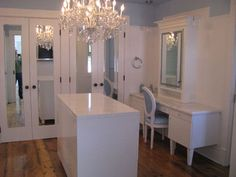 Wesley Ellen Design & Millwork - closets - dressing room, Hollywood glitz, custom closets, closet island, closet chandelier,  Walk-in closet
