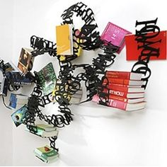 WOKmedia's Between the Lines bookshelf asks you to place your books inside their maze of words. In other words, what you're reading is between the lines.