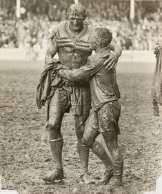 Opposing team captains Norm Provan and Arthur Summons embrace after the 1963 Australian rugby league final. [[MORE]] Solsken: This image has gone on to become the basis of the trophy that the winner of the national rugby league competition of. Australian Rugby League, Australian Football, Iconic Photos, Old Photos, Canterbury Bulldogs, National Rugby League, Hot Rugby Players, Rugby Men, Rugby Sport