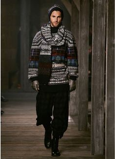 chanel pre-fall 2013. this looks norwegian, obviously. i wonder if the colors are sewn-on tweed. in this photo, it looks knitted, but in some of its other iterations, it almost looks as if woolen tweeds were appliqued on. cheers, dana