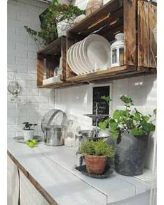 Cool idea to use wood crates as upper cabinets! #tinyhouse #tinykitchen by tinyvegantraveler
