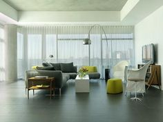 High rise apartment by Studio Durham Architects with Flos Arco and Artemide Tolomeo