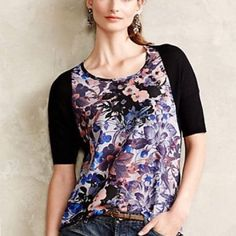 Anthropologie high low shirt Anthropologie high low shirt. Beautiful watercolor floral design with light stretchy black thin sweater material. Flowing and like new. Anthropologie Tops