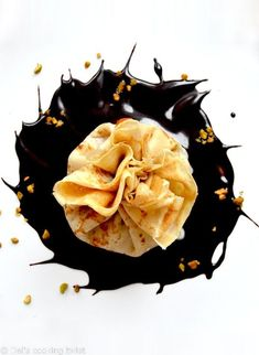 These fancy crepes filled with a delicious exotic filling consisting of chocolate, mango and coconut are tied up with a lovely ribbon around. Aren't they the prettiest? #partyfood #