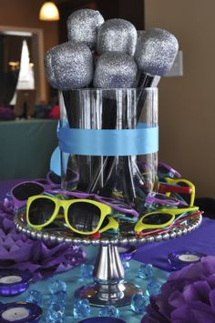Microphones and sunglass crafts doubled as the centerpiece for a lip sync/kareoke party.