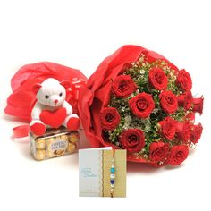 Check out our New Product  Rakhi Love Hamper No Flower COD 12 Red Roses in a paper packing with red ribbon bow, Ferrero rocher 200gm, 6inch cute soft toy and Rakhi with roli chawal.  ₹1,899