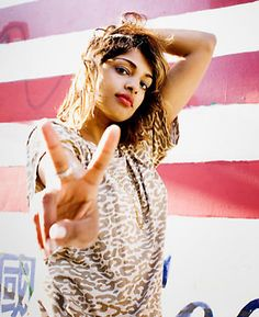 Investigate M. I. A. 's politics. She is my new idol artistically but a possible enemy politically. She glorifies war, but perhaps ironically?  She's hard to pin down.