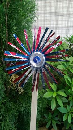repurposed aluminum cans and a few bottle caps are now a pinwheel
