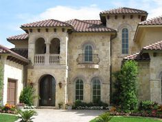 Dallas Home Experts Team saved to Dallas Luxury Tuscan. Homes like this also remind me of a Spanish winery and estate style home, heavy use of stone, iron, and wood, my favorite building elements. Tuscan Style Homes, Mediterranean Style Homes, Tuscan House, Mediterranean House Exterior, Spanish House, Spanish Style, Style Toscan, Le Riad, Mediterranean Architecture