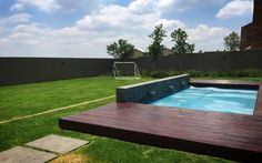 Deck with pool wall war we feature Soccer field