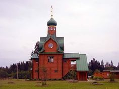The newly built wooden Russian Orthodox Church of the Presentation of the Lord at Samuskino village, Volkhov region, Russia.