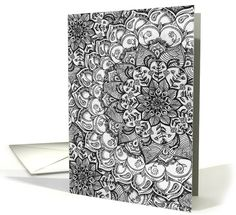 A highly detailed, hand drawn, zentangle style, floral doodle mandala in shades of grey, black and white. This decorative, patterned card is blank inside for your own message and suitable for a variety of occasions.