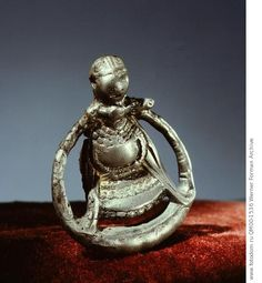 Pendant representing the goddess Freya. Around her shoulders is the necklace Brisingamen made for her by the dwarves. Country of Origin: Sweden. Culture: Viking. Credit Line: Werner Forman Archive/ Statens Historiska Museum, Stockholm . Location: 18.
