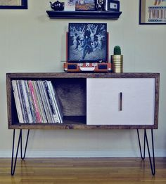 """Modern Arks made you a place to store even more of your records. This record cabinet is 42"""" x 15"""" x 29"""" and features an authentic reclaimed barn-wood exterior with one white-washed sliding door. Store hundreds of your favorite LPs in this mid-century modern styled reclaimed wood storage piece. The Eames style hairpin legs complete the feeling of nostalgia while offering a truly one-of-a-kind finish. Sit your record player right on top--and turn up the tunes."""