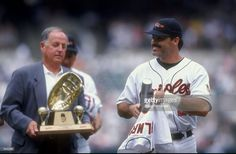 First baseman Rafael Palmeiro #25 of the Baltimore Orioles (right) receives the Gold Glove award from General Manager Pat Gillick during a game against the Seattle Mariners at the Camden Yards in Baltimore, Maryland. The Mariners defeated the Orioles 10-4.
