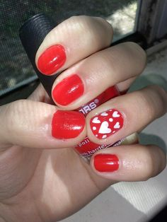 Red nails with hearts!! Great for anniversary idea!