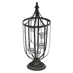 Antiqued iron candleholder. Holds 5 votive candles.  Product: Candleholder    Construction Material: Iron and glass