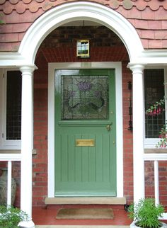 Arch frames front door perfectly; the stained glass is beautiful.