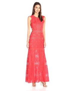 95a6657c7ec09 In textural floral and striped laces, this sweeping evening gown makes a  statement with its