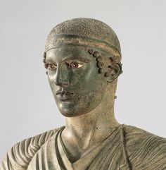 """Charioteer of Delphi        """"Victory is as transient as a young man's perfect beauty, which the Greek  described as a flower that blooms and vanishes."""" –Camille Paglia, Glittering Images"""
