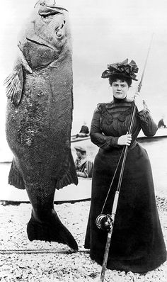 Santa Catalina, California 1901.A woman in Victorian dress stands next to her prize catch of a 363 pound black sea bass.