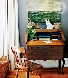 French writing desk. It holds personalized stationery, etc., without taking up too much space in the room.