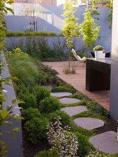 Highfield Road - Ben Scott Garden Design | Freeform pavers surrounded by dichondra