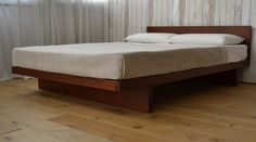 A one-off king-size Kyoto bed in solid utile wood - stunning! http://www.naturalbedcompany.co.uk/shop/contemporary-beds/kyoto-wooden-bed-special-edition/