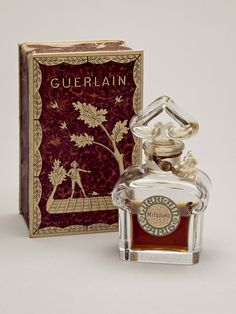 This is the rare 1919 Guerlain bottle created by Baccarat to a design by Raymond Guerlain for the perfume MITSOUKO (which in Japanese means Mystery). The bottle is made of glass crystal with both stopper and bottle having been issued with matching etched numbers which indicates that a limited number of this designer bottle was produced. The bottle in this picture still contains some of the original perfume and its box is intact, which makes it even more rare.
