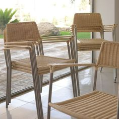 Contemporary chair / with armrests / stackable / rattan ALGAR by Ximo Roca  POINT