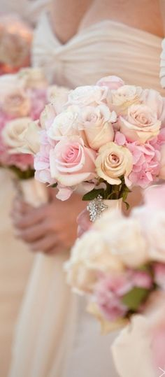 pretty pink and cream roses look gorgeous against the ivory bridesmaids dresses during the ceremony Ivory Bridesmaid Dresses, Bridesmaid Bouquet, Wedding Bouquets, Pink Bridesmaids, Ivory Dresses, Floral Wedding, Wedding Colors, Wedding Flowers, Perfect Wedding
