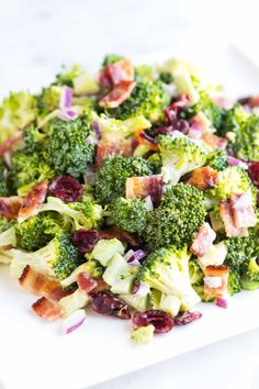 Easy broccoli salad recipe with bacon, cranberries, red onion and a zesty dressing made with mayonnaise, Dijon mustard and apple cider vinegar (from Inspired Taste). Easy Broccoli Recipes, Salad Recipes With Bacon, Easy Broccoli Salad, Easy Salad Recipes, Potluck Recipes, Easy Salads, Easy Meals, Cooking Recipes, Healthy Recipes