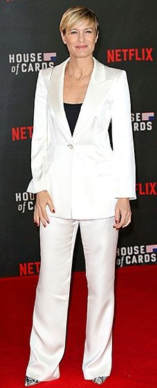 First Lady of Style! Wright premiered the latest season of Netflix's hit political drama in a white tuxedo and snakeskin pumps.