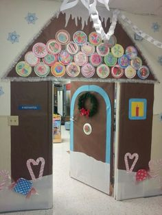 My pinterest inspired gingerbread house classroom door! The candies are paper plates wrapped with clear cello wrap from the dollar store. The roof is made of kid colored paper plate candies and I lined it with white garland. I covered the top part of the door (to my height) for added fun. There are also snowflakes with the kids' pictures and names surrounding it.