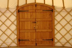 Arched double oak door and frame in yurt.