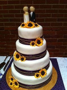 I like the sunflowers on this cake with camo ribbon around the bottom instead of brown.