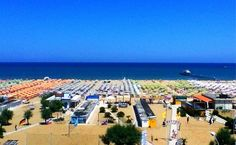 """Rimini, Italy.  """"Colored umbrellas grid the entire beach as far as your eyes can see"""" by @Norbert Widhalm Figueroa"""