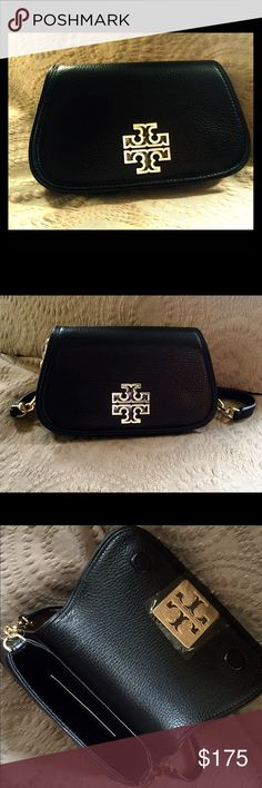 "New Tory Burch BRITTEN MINI CROSS-BODY New, never used, authentic Tory Burch Britten Mini Cross-Body black bag with a cut-out double-T logo:   ·        Soft pebbled leather  ·        3 slots for credit cards  ·        Interior fits an iPhone 6, lipstick and a makeup compact  ·        Fold-over flap with magnetic snap closure  ·        Adjustable, removable cross-body strap with 23"" (58.5 cm) drop - converts to a mini bag or clutch  ·        Height: 4.78"" (12 cm)  ·        Length: 7.97"" (20…"