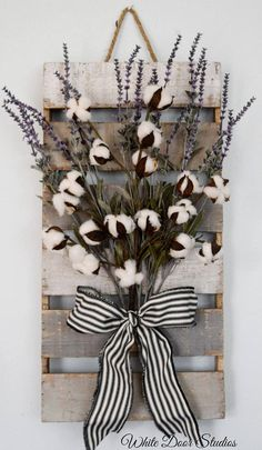 Farmhouse chic in an unexpected way. Faux lavender, rustic cotton stems and a rustic wood pallet come together to create a warm and inviting piece perfect for any room of your home. An original design from White Door Studios. A Pinterest favorite with 70,000+ pins! Wall hanging